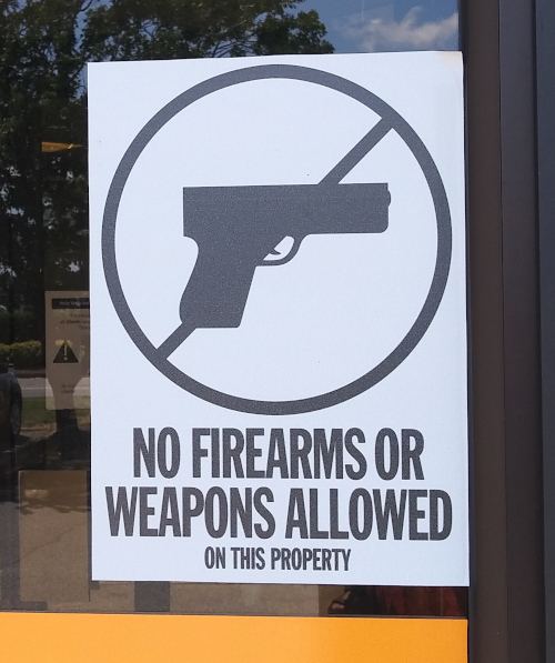 """Sign reading """"No Firearms or Weapons Allowed on This Property."""